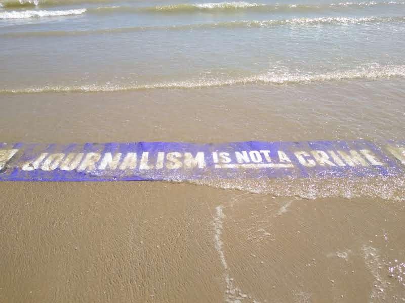 protest_photos:beachsign.jpg